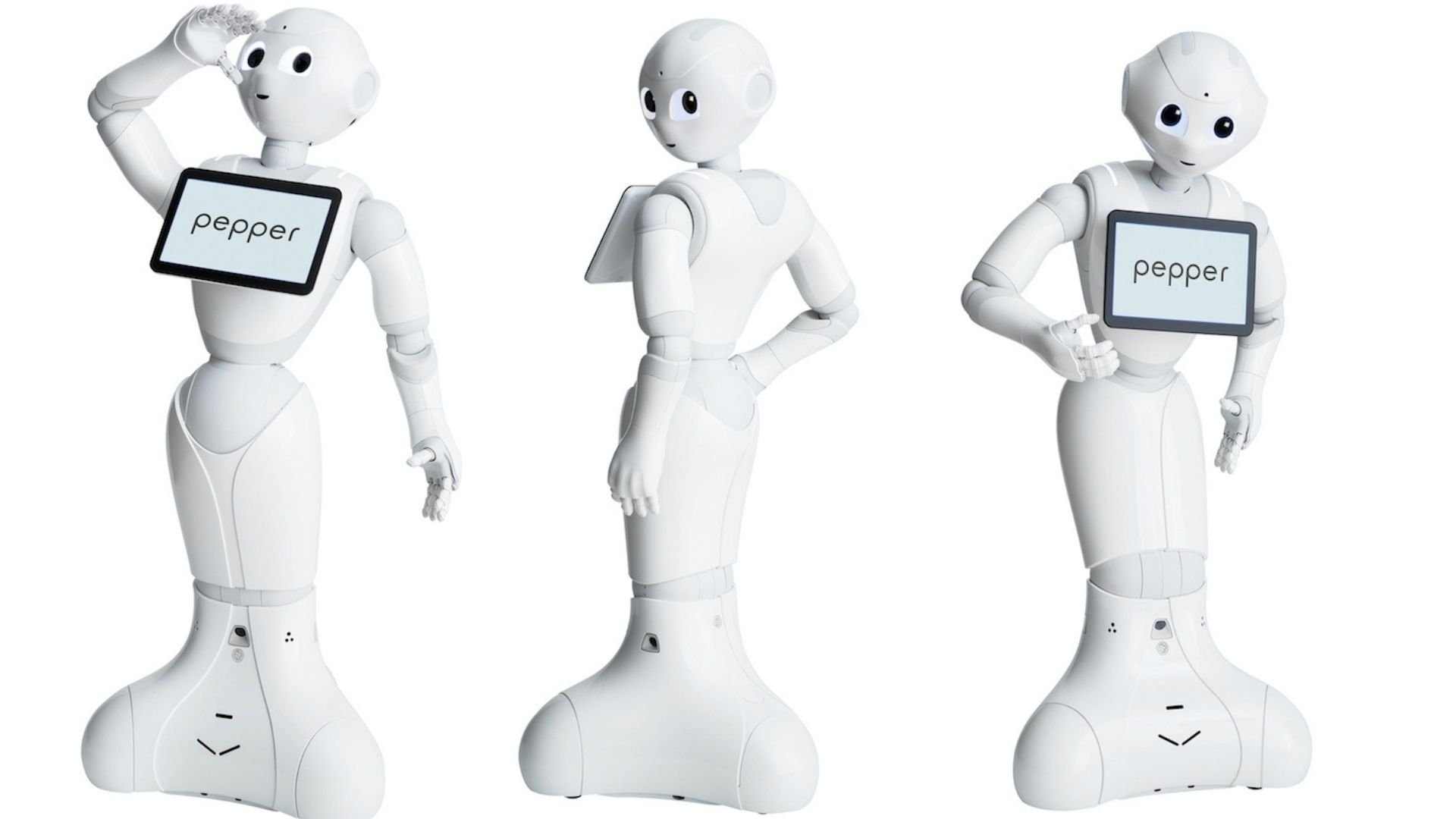 Image of three white 'Pepper' robots in different poses