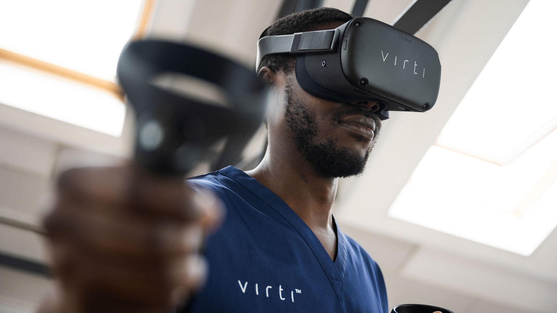 Black man using the Virti artificial experiential training virtual reality device