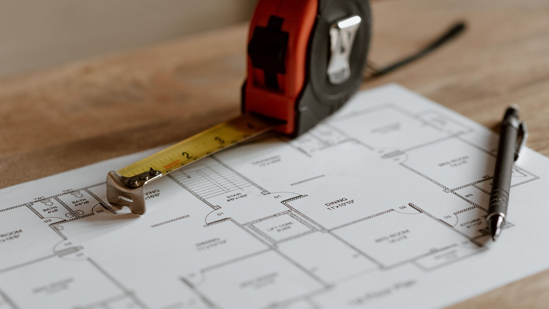 Construction plan with tape measure