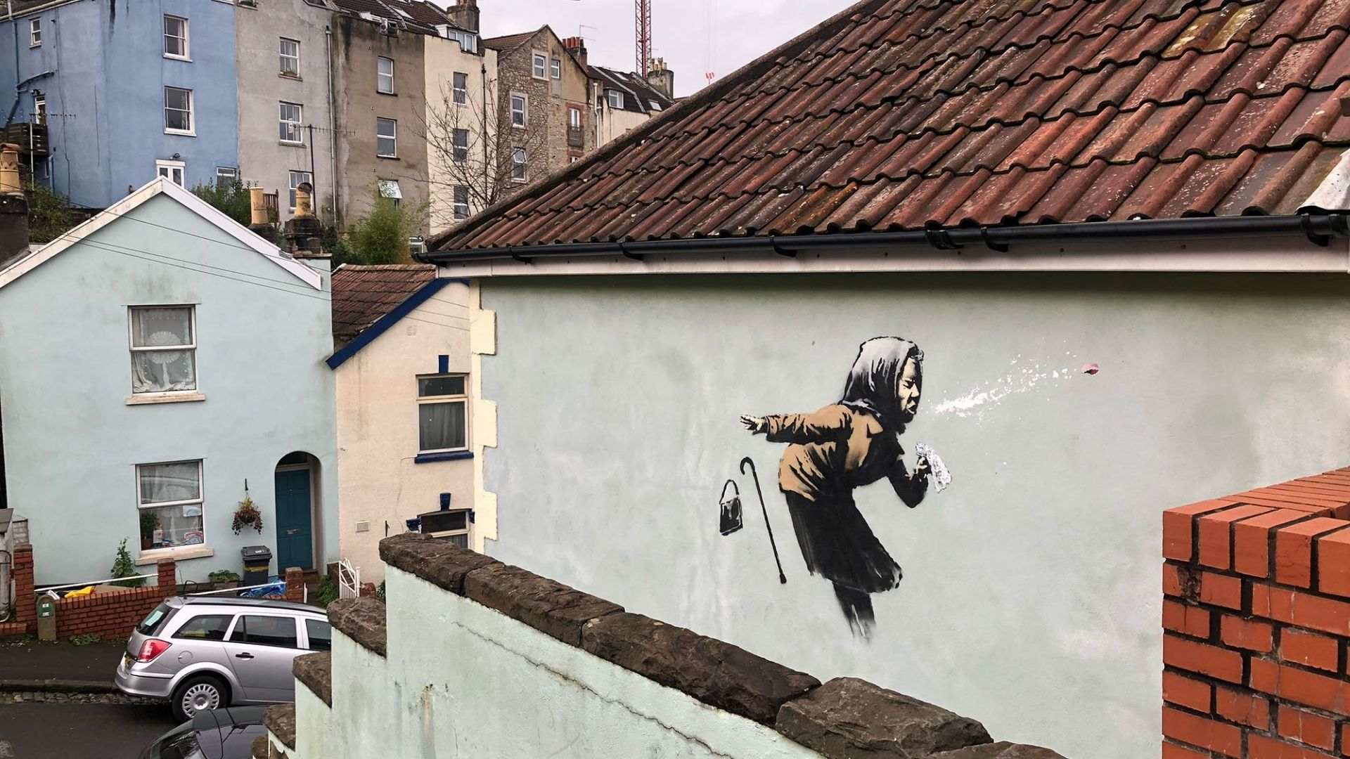 Photo of the Banksy piece 'Aachoo!!' on a house on Vale Street in Totterdown, Bristol